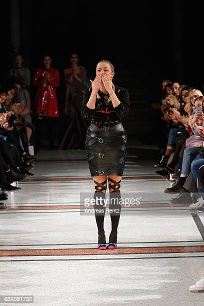 Marina Hoermanseder acknowledges the applause of the audience after her show during the Der Berliner Mode Salon A/W 2017 at Kronprinzenpalais on...