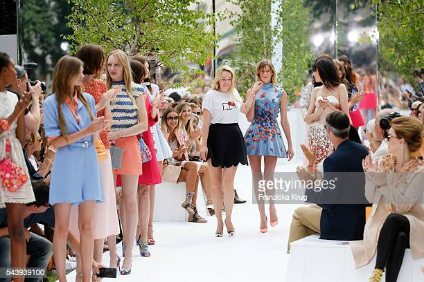 Marina Hoermanseder and her models are seen on stage of the presentation of the Rauch Happy Day Limited Edition designed by Marina Hoermanseder ahead...