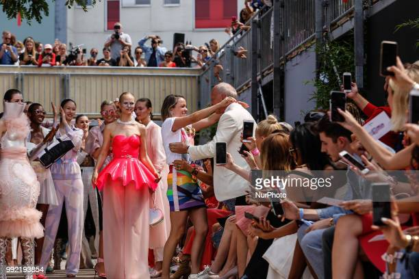 Marina Hoermanseder hugs her father after the Spring/Summer 2019 collection show during the third day of MBFW Berlin Fashion Weak in the ewerk in...