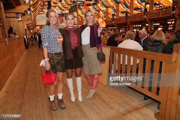 """Marina Hoermanseder, Kiera Chaplin and Larissa Laudenberger granddaughter of Charlie Chaplin, during """"Veuve Clicquot Business Women Wiesn"""" as part of..."""