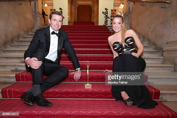 Marina Hoermanseder presents her award with Chris Collet at the Look Women of the Year Awards at City Hall on November 30 2016 in Vienna Austria
