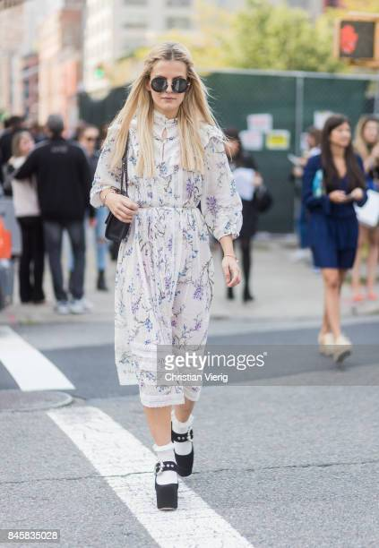 Marina Ilic wearing a white dress seen in the streets of Manhattan outside Zimmermann during New York Fashion Week on September 11 2017 in New York...