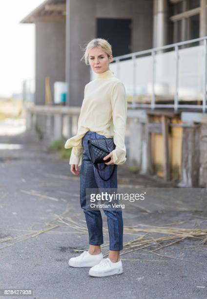 Marina Ilic wearing yellow longshirt denim jeans outside By Malene Birger on August 09 2017 in Copenhagen Denmark