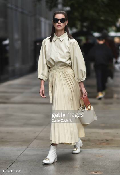 Marina Ingvarsson is seen wearing a cream top and skirt and white boots outside the Rag Bone show during New York Fashion Week S/S20 on September 06...