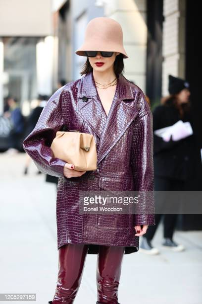 Marina Ingvarsson is seen wearing a Tibi coat, hat and maroon boots outside of Spring Studios during New York Fashion Week on February 09, 2020 in...