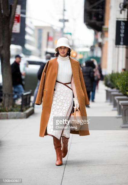 Marina Ingvarsson is seen wearing brown coat, white bucket hat, knit, skirt outside Zimmermann during New York Fashion Week Fall / Winter on February...