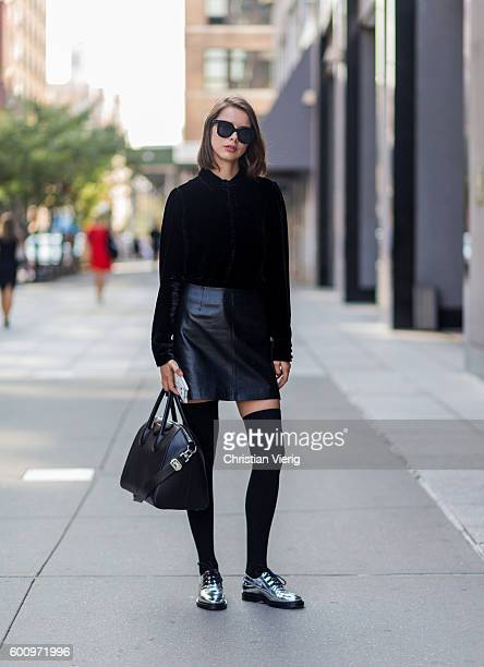 Marina Ingvarsson wearing a black jacket Givenchy bag black leather skirt and overknee socks and silver shoes outside Noon By Noor on September 8...