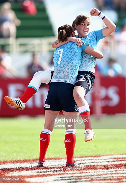 Marina Kukina of Russia is congratulated by team mate Daria Lushina after scoring a try against England in the semi final of the Emirates Dubai Rugby...