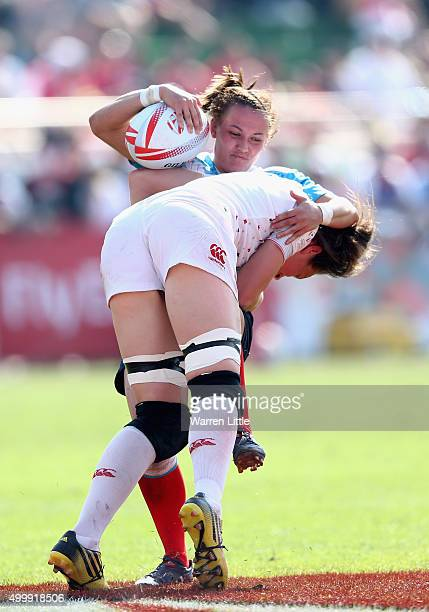 Marina Kukina of Russia is tackled by Emily Scarratt of England during the Emirates Dubai Rugby Sevens HSBC World Rugby Women's Sevens Series at The...