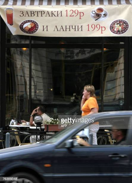 """Marina LAPENKOVA A restaurant advertises using the Russian word for breakfast, top, and the transliterated word """"lunch"""" in Moscow, 28 August 2007...."""