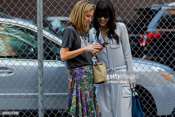 Marina Larroude showing Mariah Bernardes something on her phone outside Creatures of the Wind on September 8 2016 in New York City