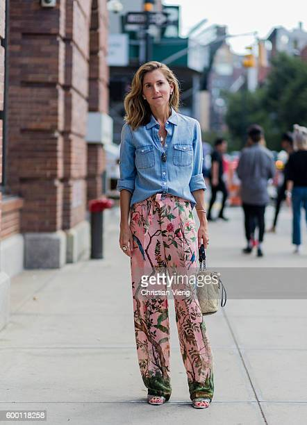 Marina Larroude wearing a denim shirt pink wide leg pants with floral print outside Parsons on September 7 2016 in New York City
