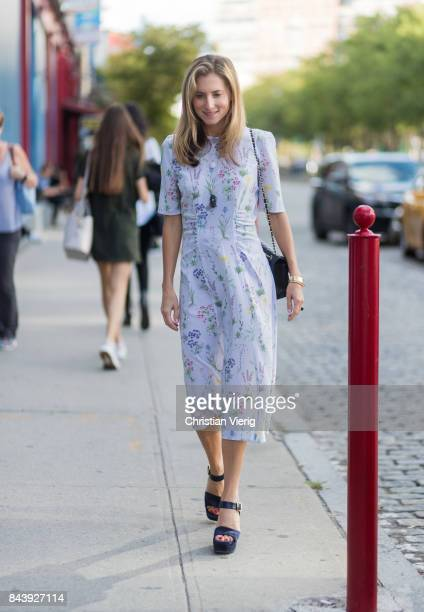 Marina Larroude wearing a dress plattform sandals seen wearing in the streets of Manhattan outside Ulla Johnson during New York Fashion Week on...