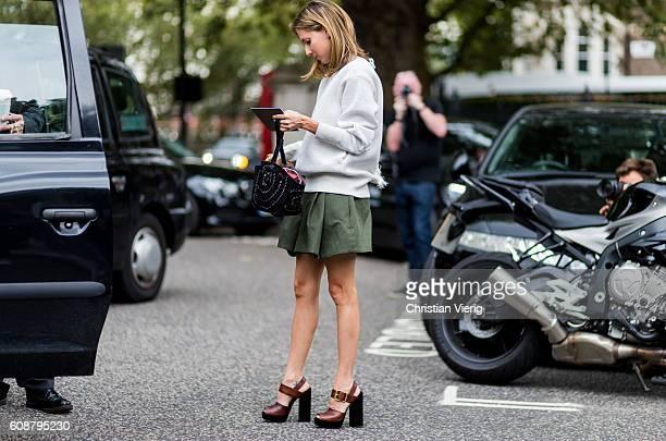 Marina Larroude wearing a white jumoer and khaki mini skirt outside Christopher Kane during London Fashion Week Spring/Summer collections 2017 on...