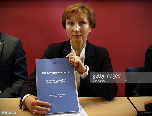Marina Litvinenko holds a copy of the inquiry report as she attends a press conference at her lawyer's office after receiving the results of the...