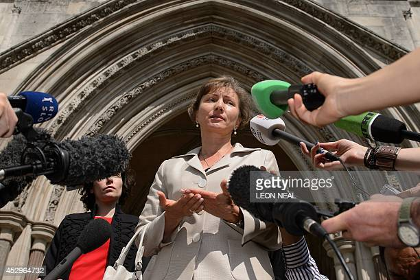 Marina Litvinenko the widow of Russian former spy Alexander Litvinenko speaks to the media outside the High Court in central London on July 31 2014...