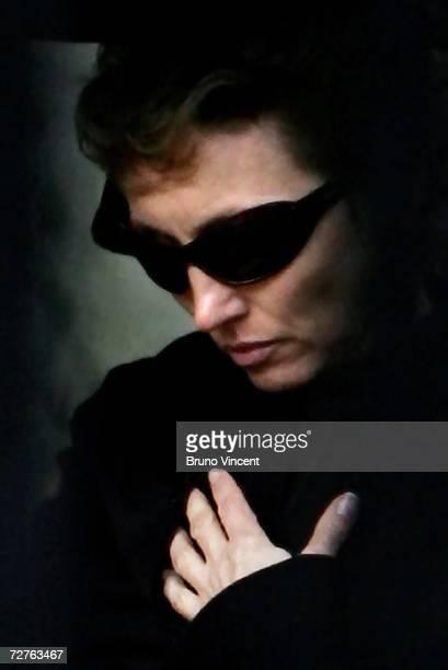 Marina Litvinenko the wife of poisoned former Russian KGB spy Alexander Litvinenko walks through Highgate Cemetary after his funeral on December 7...