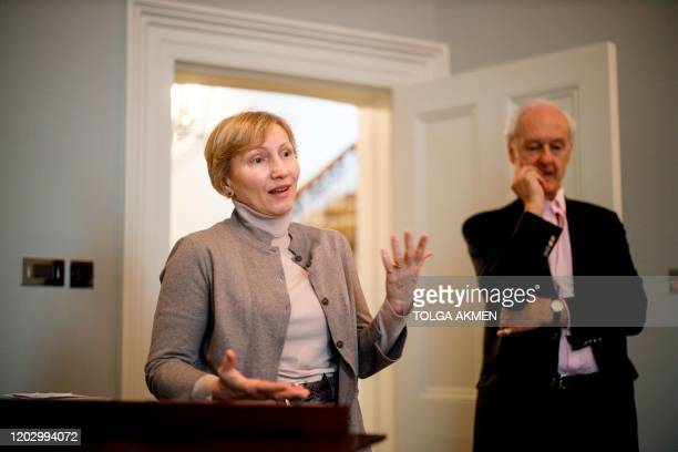 Marina Litvinenko, widow of murdered Russian ex-spy Alexander Litvinenko, talks to members of the media with composer Anthony Bolton standing by...