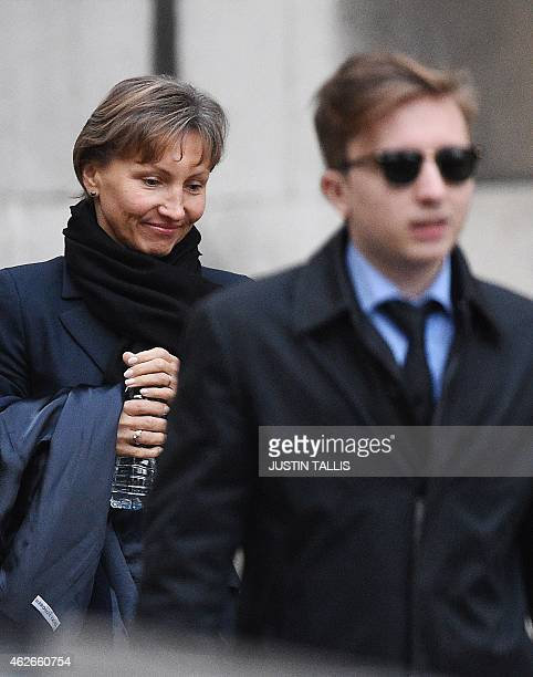 Marina Litvinenko widow of Russian former spy Alexander Litvinenko and her son Anatoly leave the Royal Courts of Justice in London on February 2 2015...