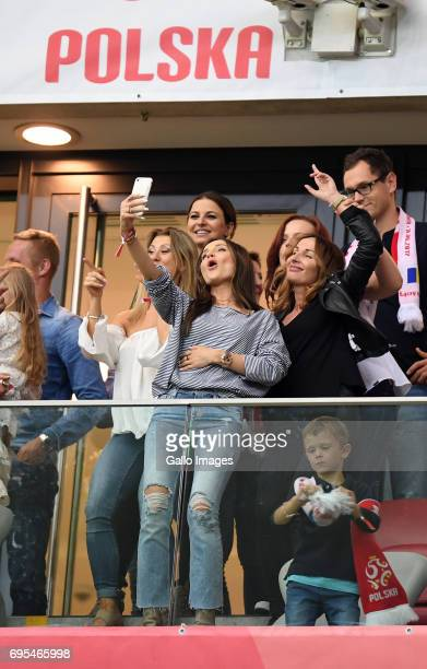 Marina Luczenki of Wojciech Szczesny of Poland Anna Lewandowska of Valeri Kazaishvili of Legia Warszawa takes a selfie during the 2018 FIFA World Cup...