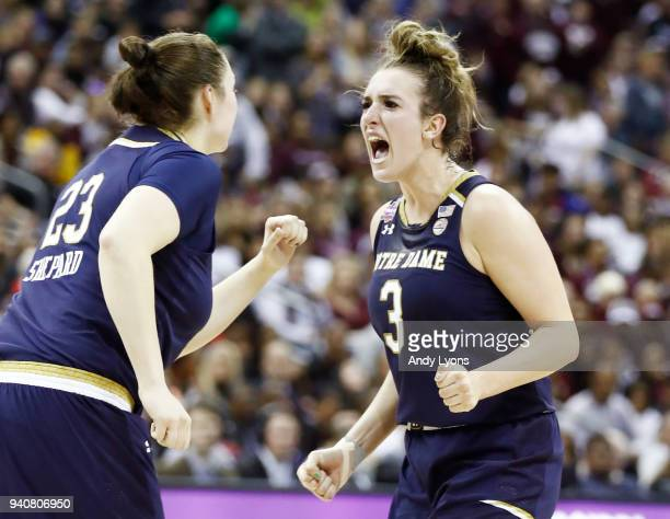 Marina Mabrey and Jessica Shepard of the Notre Dame Fighting Irish celebrate their comeback during the third quarter against the Mississippi State...