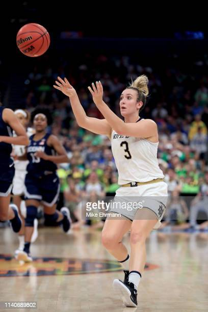 Marina Mabrey of the Notre Dame Fighting Irish attempts a pass against the UConn Huskies during the first quarter in the semifinals of the 2019 NCAA...