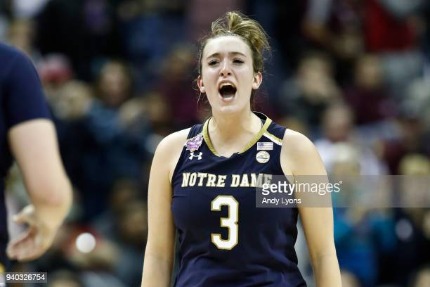 Marina Mabrey of the Notre Dame Fighting Irish celebrates her teams lead late in the game against the Connecticut Huskies during the second half in...