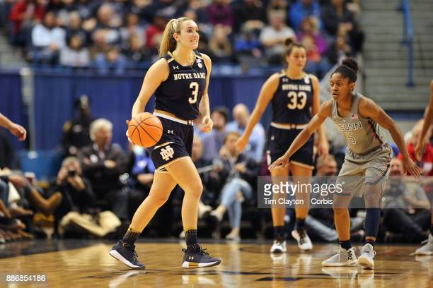 Marina Mabrey of the Notre Dame Fighting Irish defended by Crystal Dangerfield of the Connecticut Huskies during the the UConn Huskies Vs Notre Dame...