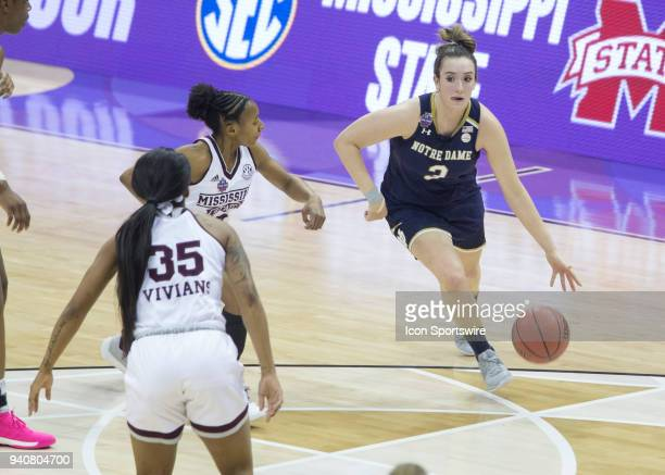 Marina Mabrey of the Notre Dame Fighting Irish dribbles to the hoop during the National Championship game between the Mississippi State Lady Bulldogs...