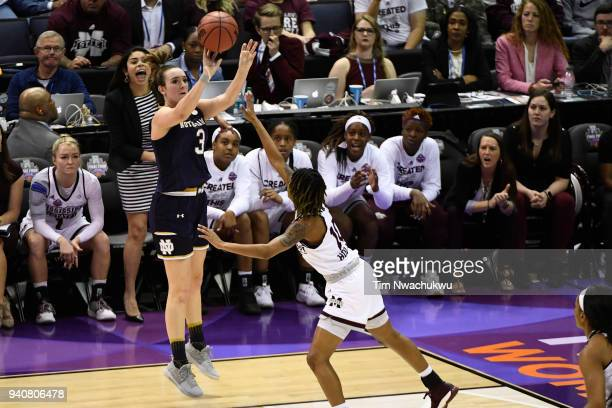 Marina Mabrey of the Notre Dame Fighting Irish shoots a jump shot as Jazzmun Holmes of the Mississippi State Bulldogs defends during the championship...