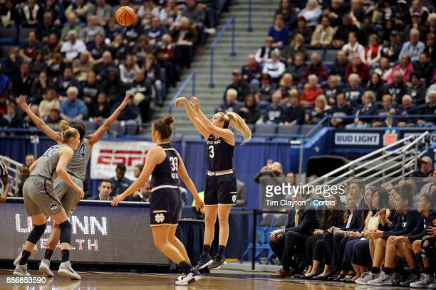 Marina Mabrey of the Notre Dame Fighting Irish shoots for three while defended by Napheesa Collier of the Connecticut Huskies during the the UConn...
