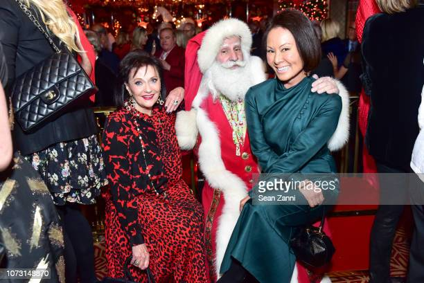 Marina Maher Santa Claus and Alina Cho attend George Farias Anne Jay McInerney Host A Holiday Party at The Doubles Club on December 13 2018 in New...