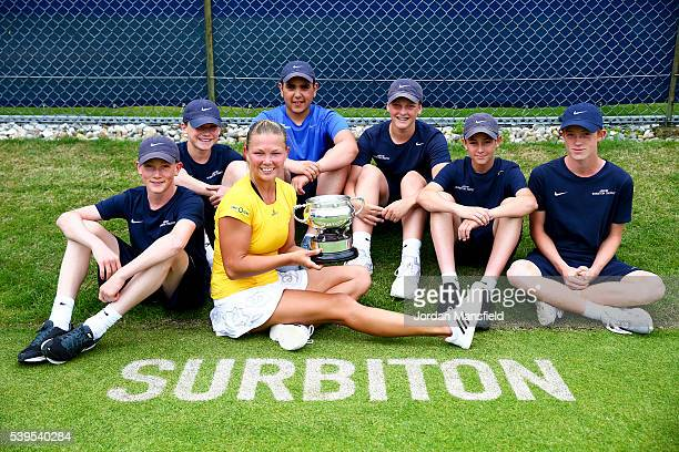 Marina Melnikova of Russia poses with the trophy and the ballkids after winning her Women's Final match against Stephanie Foretz of France during day...