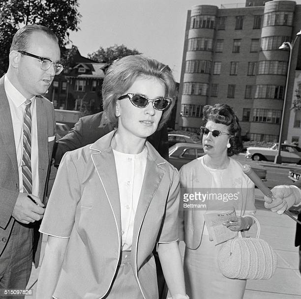Marina Oswald arrives to testify at Warren Commission hearings into her husband's role in the assassination of President Kennedy