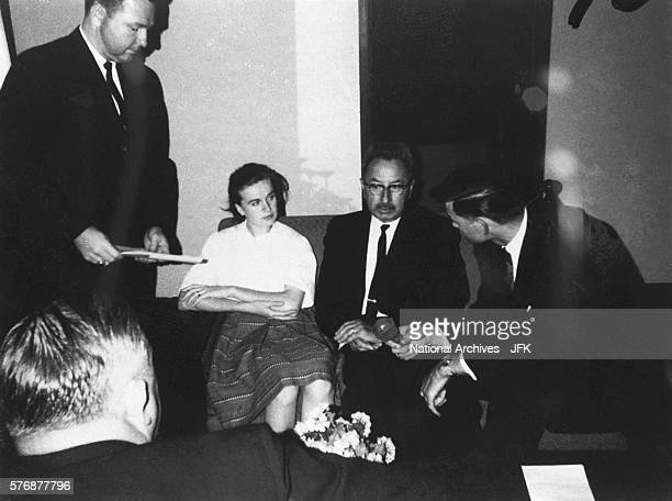 Marina Oswald the wife of Lee Harvey Oswald sits between James Howard and Peter Gregory as Charles Kunkel asks a question during her interview...