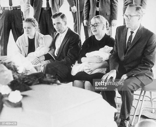 Marina Oswald widow of alleged presidential assassin Lee Harvey Oswald sits with family next to her husband's casket The Reverend Louis Saunders sits...