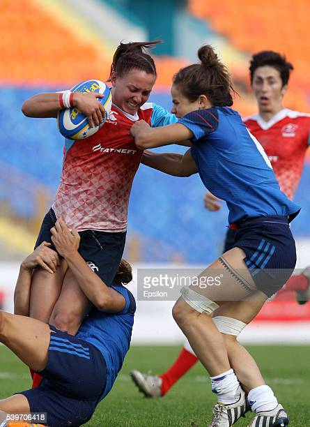 Marina Petrova of Russia and Camille Grassineau of France vie for the ball during the Rugby 7's Grand Prix Series Women final match between Russia...
