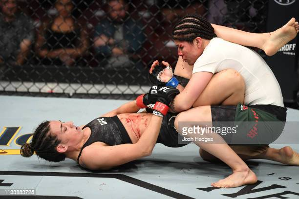 Marina Rodriguez of Brazil attempts to submit Jessica Aguilar in their women's strawweight bout during the UFC Fight Night event at Wells Fargo...