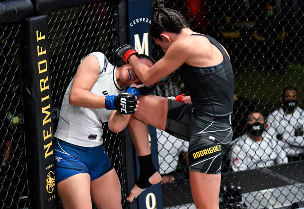 Marina Rodriguez of Brazil knees Michelle Waterson in a flyweight fight during the UFC Fight Night event at UFC APEX on May 08, 2021 in Las Vegas,...