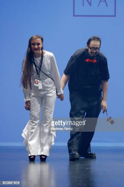 Marina Sebastian and Alejandro Delgado acknowledge the applause of the audience after the 'Malina' show at the 3D Fashion Presented By...