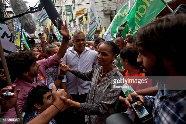 Marina Silva Brazilian presidential candidate and former Senator greets supporters as she takes part in a rally in the Rocinha slum in Rio de Janeiro...