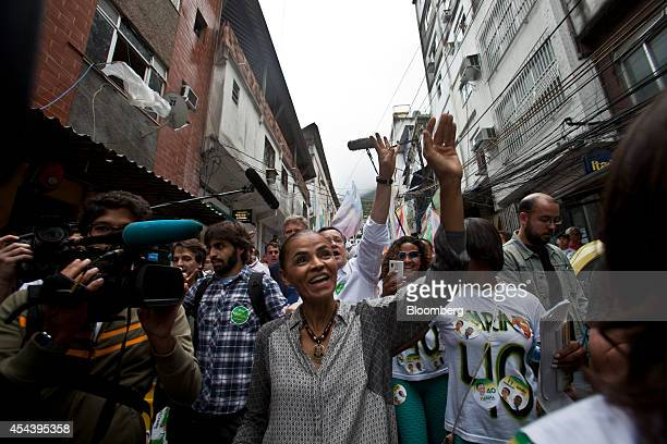 Marina Silva Brazilian presidential candidate and former Senator waves to supporters as she takes part in a rally in the Rocinha slum in Rio de...