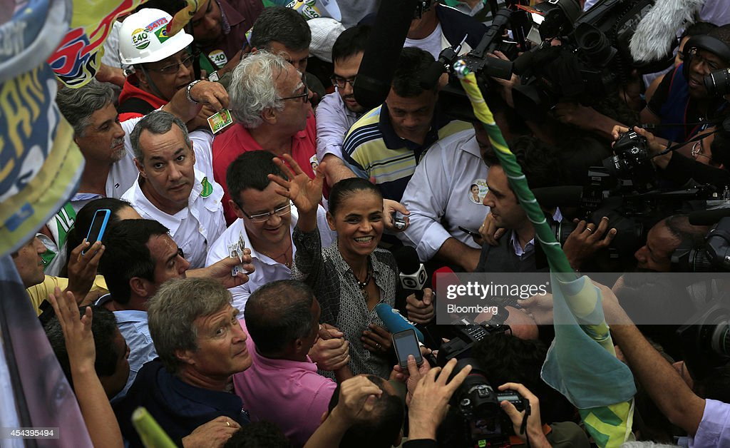 Marina Silva, Brazilian presidential candidate and former Senator, waves to supporters as she takes part in a rally in the Rocinha slum in Rio de Janeiro, Brazil, on Saturday, Aug. 30, 2014. Silva, who entered the presidential race Aug. 20, is capitalizing on voter discontent with a shrinking economy and above-target inflation. Photographer: Dado Galdieri/Bloomberg via Getty Images