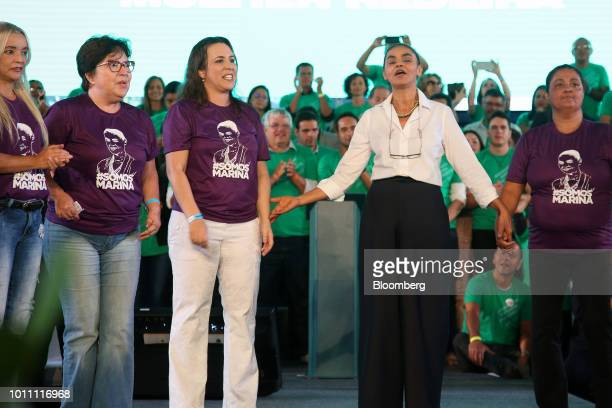 Marina Silva presidential candidate for the Sustainability Network Party second right speaks during the party's national convention at Minas Hall in...