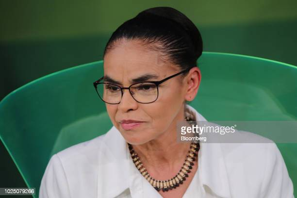 Marina Silva presidential candidate for the Sustainability Network Party listens during an event at the National Agricultural Confederation in...