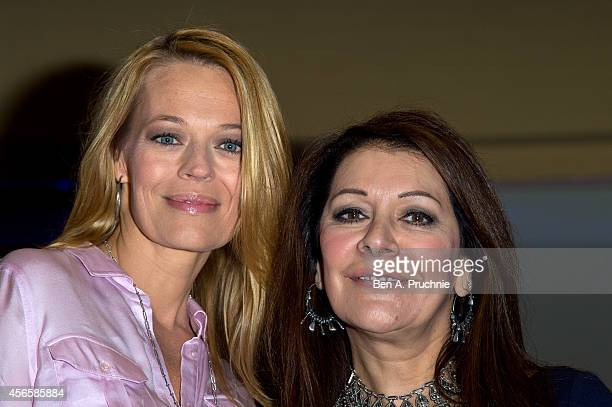Marina Sirtis and Jeri Ryan pose for photographs during the Destination Star Trek event at ExCel on October 3 2014 in London England