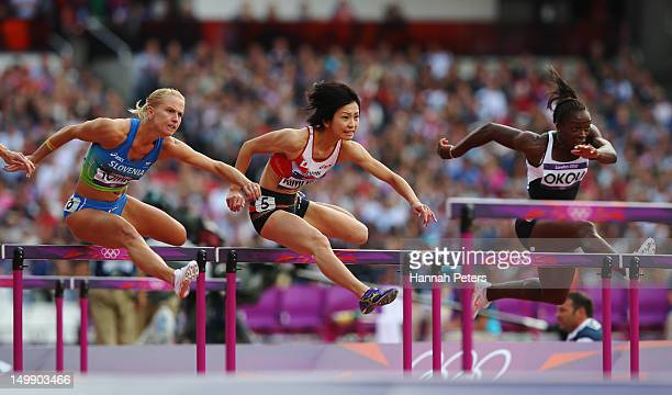 Marina Tomic of Slovenia Ayako Kimura of Japan and Rosvitha Okou of Cote d'Ivoire compete in the Women's 100m Hurdles heat on Day 10 of the London...