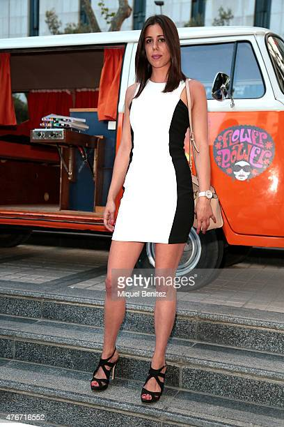 Marina wears Mango's jacket, drees and shoes, Swarovski watch and a MIchael Kors handbag on June 11, 2015 in Barcelona, Spain.