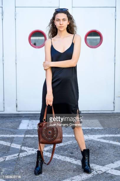 Marina wears ZARA boots and dress and Campomaggi handbag during Mercedes Benz Fashion Week Madrid Sprint/Summer 2020 at Ifema on July 07, 2019 in...
