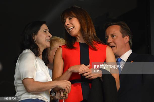 Marina Wheeler talks with Britain's Prime Minister David Cameron and Samantha Cameron prior to the start of the opening ceremony of the London 2012...